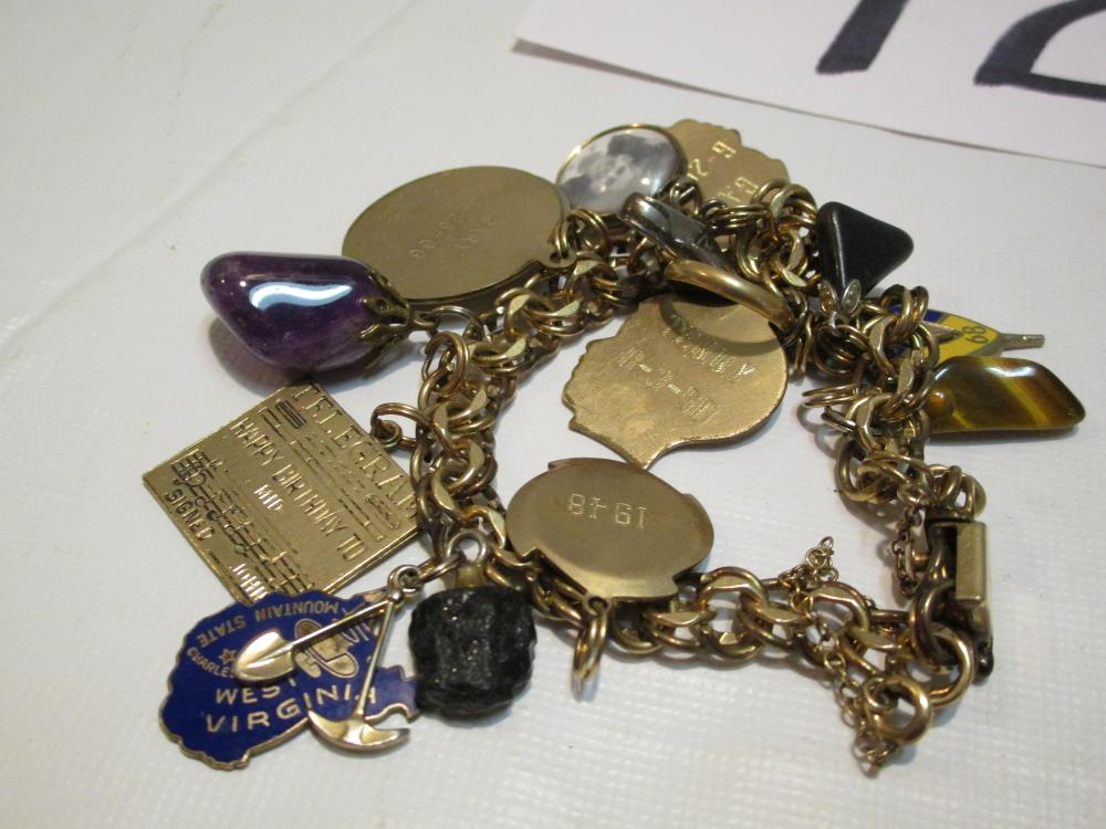 1/20th 12 kt G.f. Charm Bracelet with Charms dating from the 1940's through the 1960's