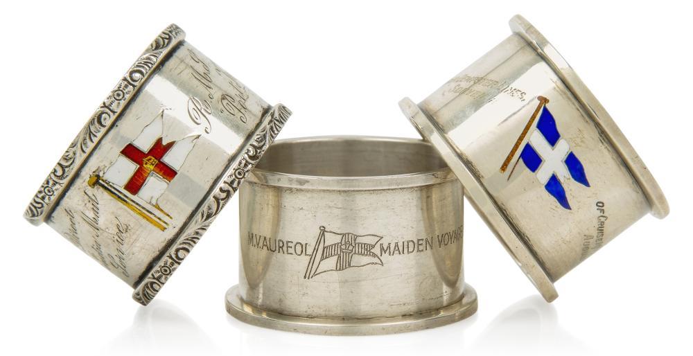 THREE SOUVENIR ENAMEL AND SILVER NAPKIN RINGS