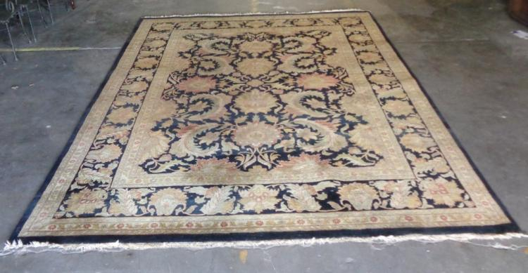 Hand Knotted Wool Rug    Beautiful large hand knotted wool rug with black background.  Terrific in any space.