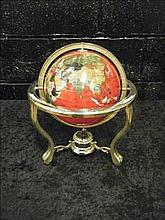 Semi-precious gemstone globe on brass stand RED