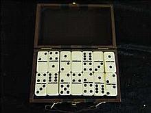 Cased set of dominoes