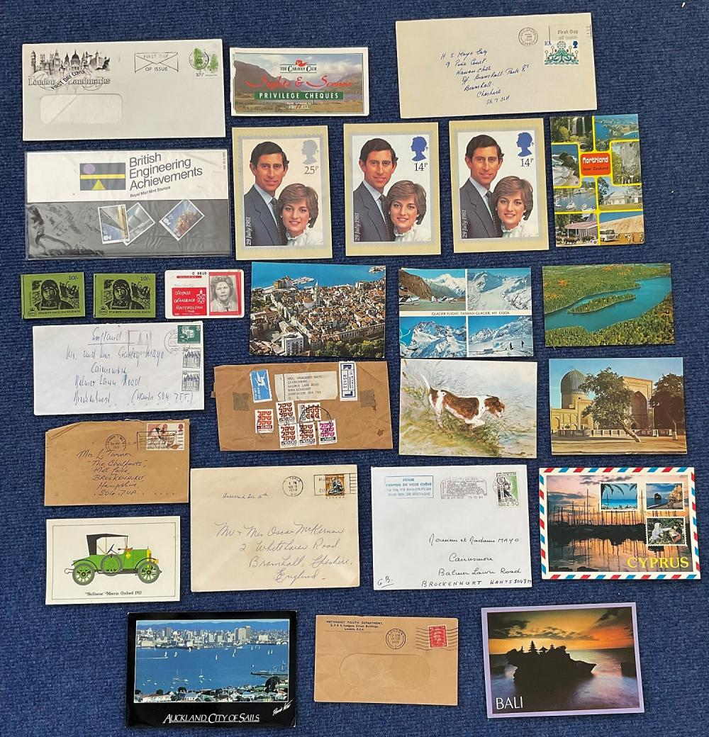 Odds and ends bundle including Postcards, loose stamps on and off paper, 2 Great Britain partially