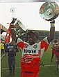 Martin Offiah, Wigan Warriors rugby legend signed high quality colour 8x10 photo. Superb shot of him celebrating after winning the 1994 Challenge Cup final at Wembley. Bold black undedicated autograph.
