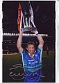Sean Long signed 12 x 8 colour Rugby Photo, St Helens legend shown holding up the Tetley Trophy