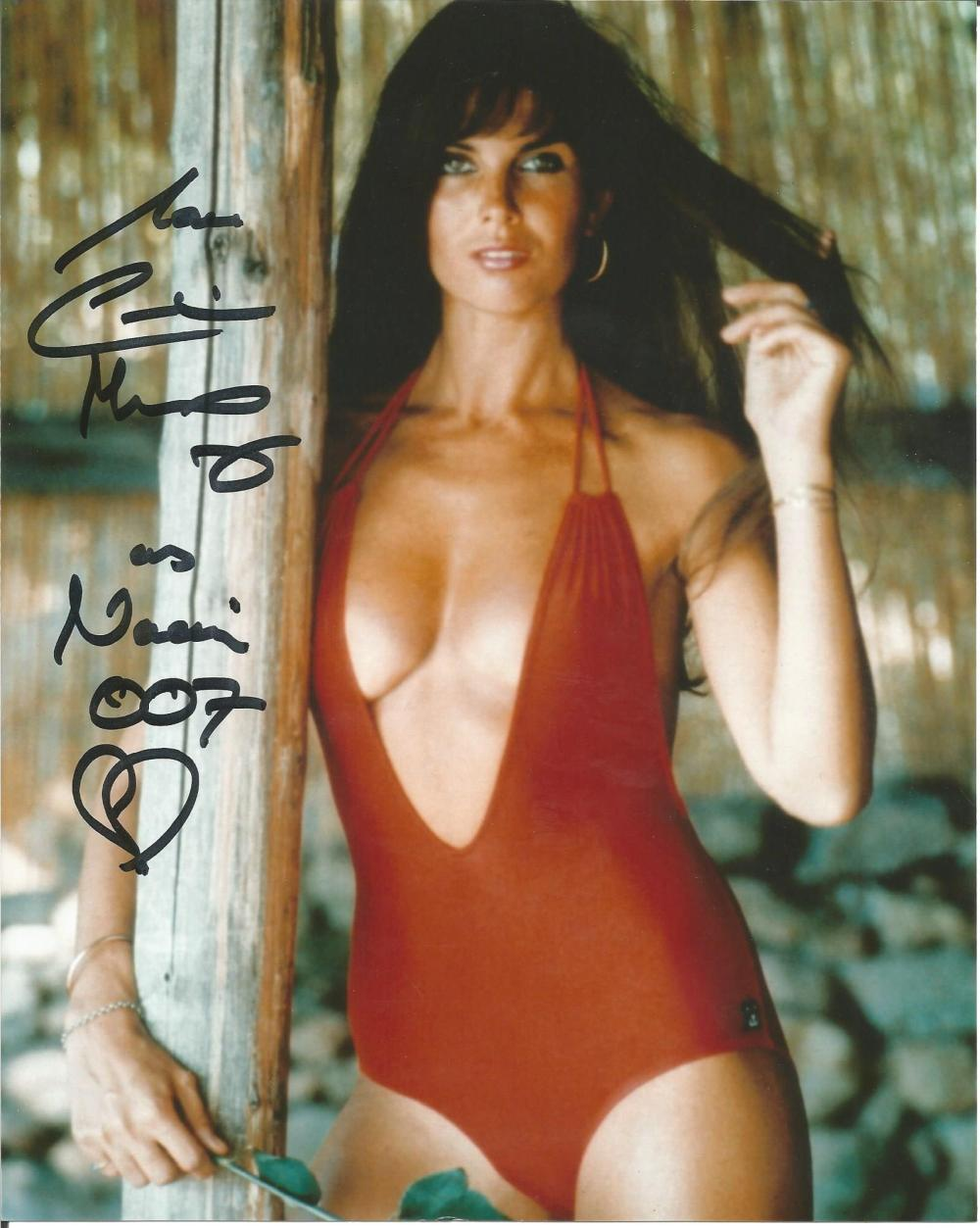 Caroline Munro super sexy hand signed 10x8 photo. This beautiful hand-signed photo depicts