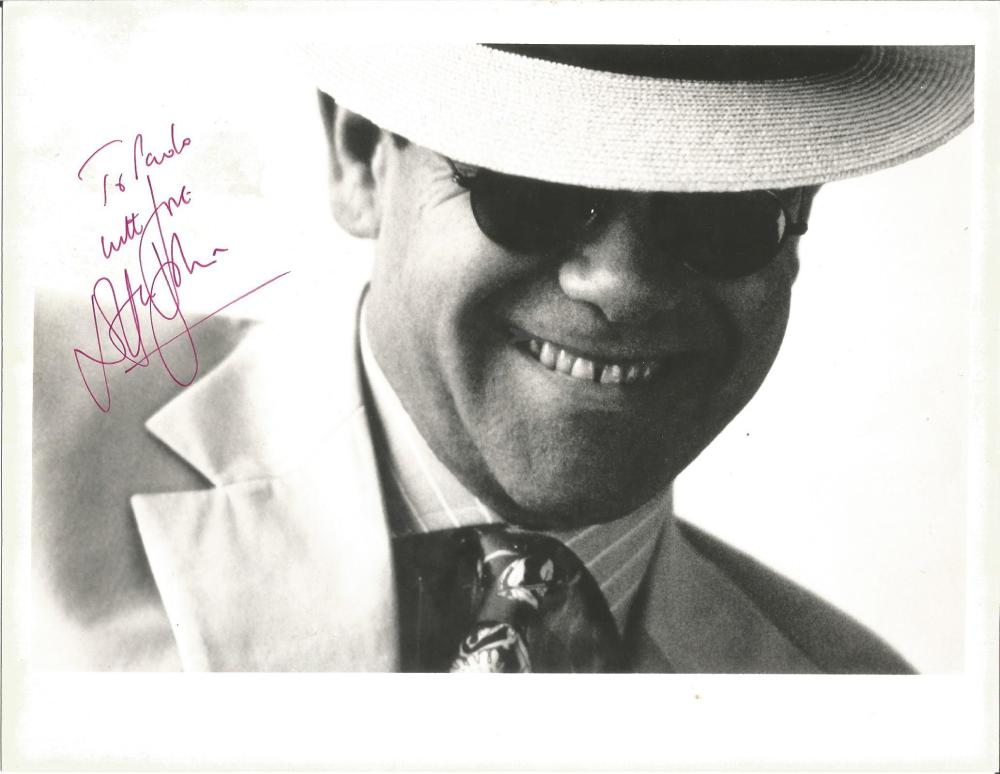 Elton John signed 10x8 b/w photo. (born Reginald Kenneth Dwight, 25 March 1947) is an English