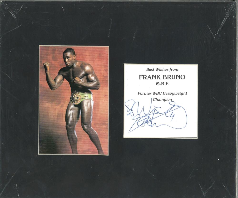 Frank Bruno signature piece mounted alongside colour photo. Approx overall size 12x10. Good
