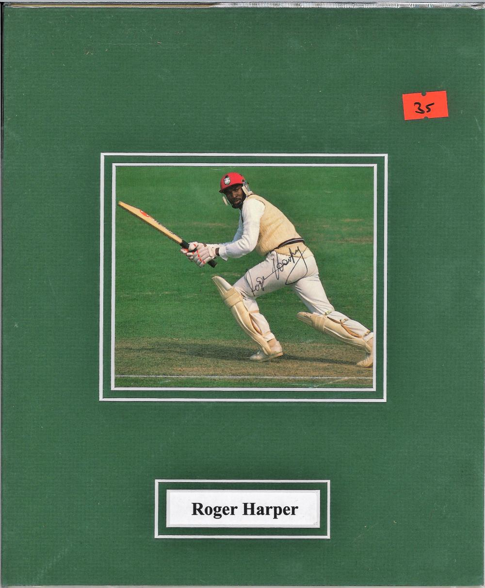 Roger Harper signed colour photo. Mounted to approx size 11x9. former West Indies cricketer turned