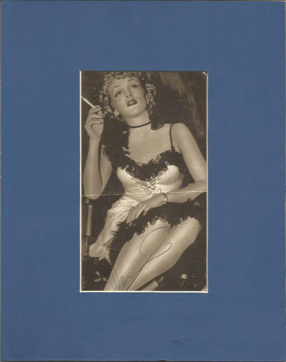 Marlene Dietrich signed and mounted b/w photo, to 10 x 8 overall size. Comes with biography