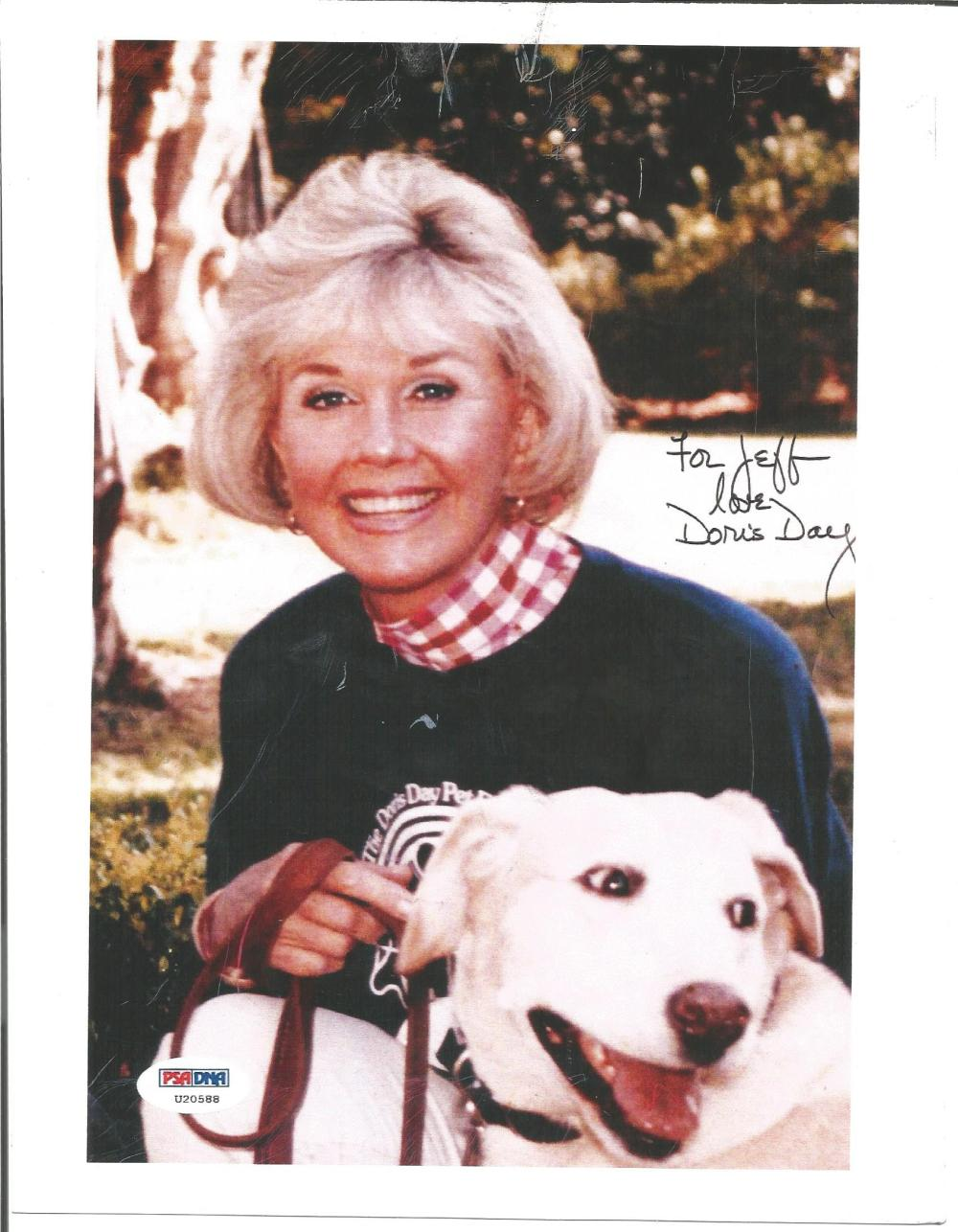Doris Day signed 10 x 8 colour photo to Jeff, seated with her dog, has PSA DNA hologram. Comes