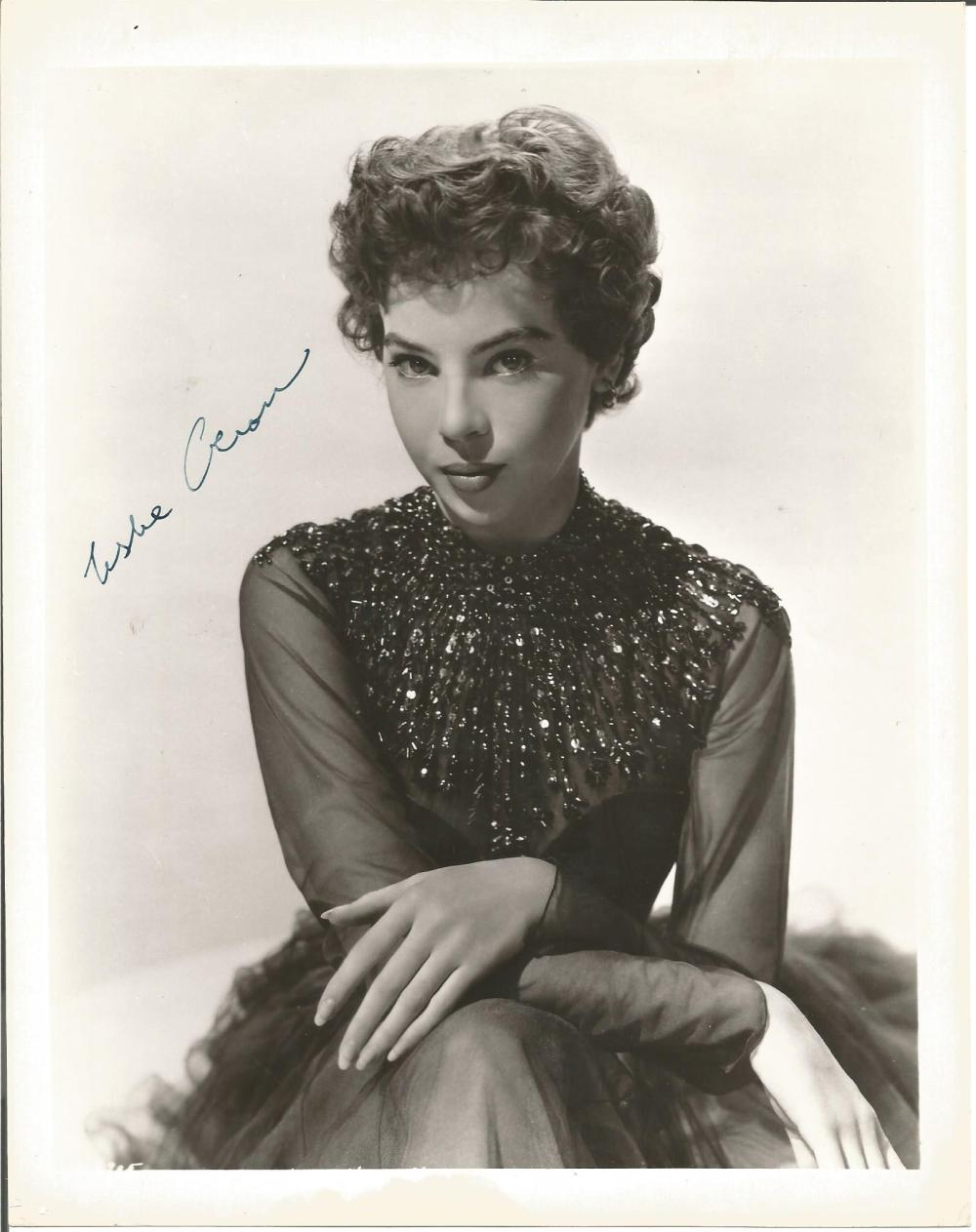 Leslie Caron signed 10 x 8 b/w vintage full length photo. Good Condition. All signed pieces come