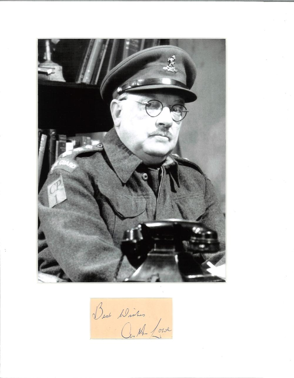 Arthur Lowe signature piece mounted below b/w photo as Captain Mainwaring in Dad's Army. Approx.