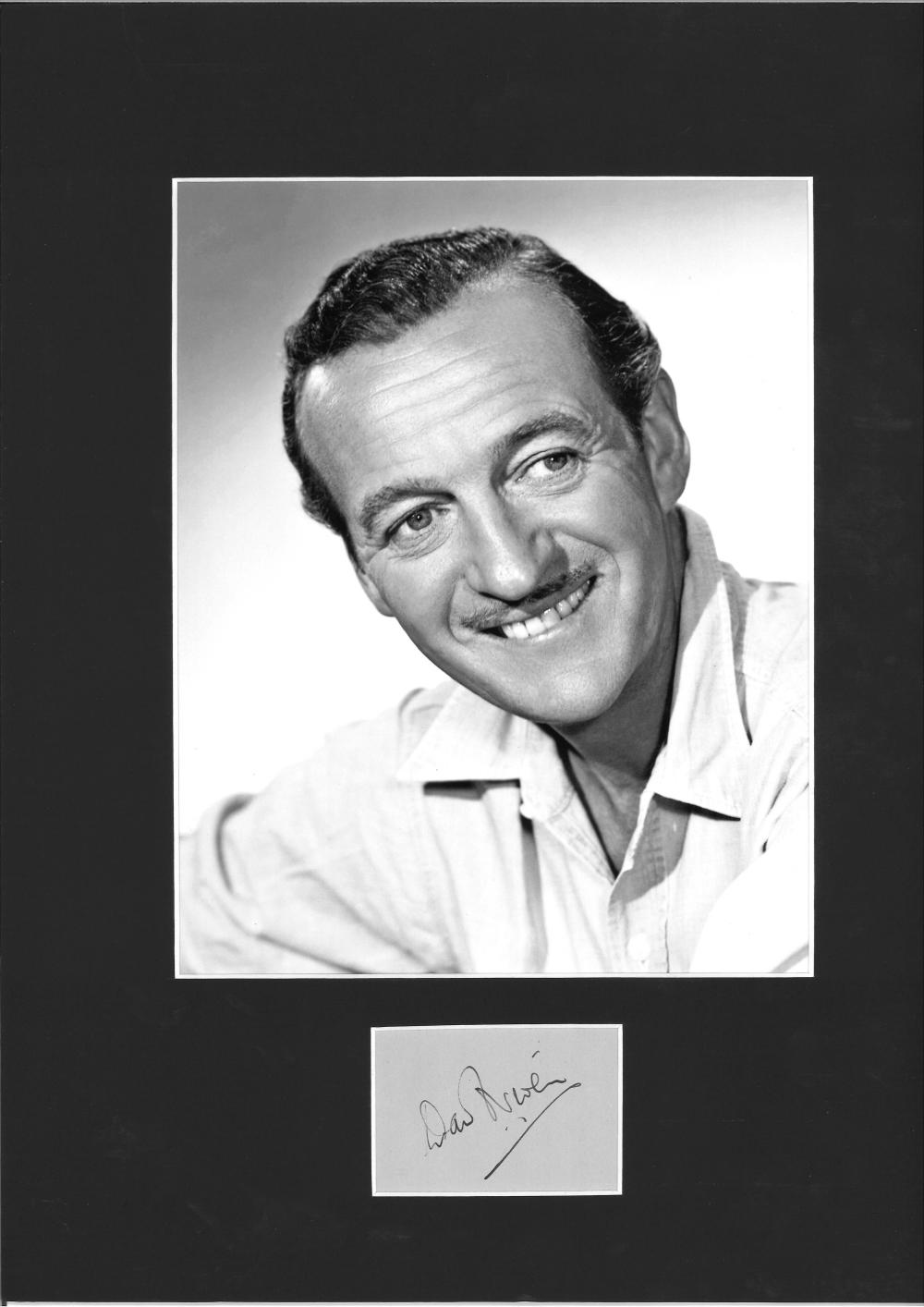 David Niven signature piece mounted below b/w photo. Approx. overall size 16x12. Good Condition.