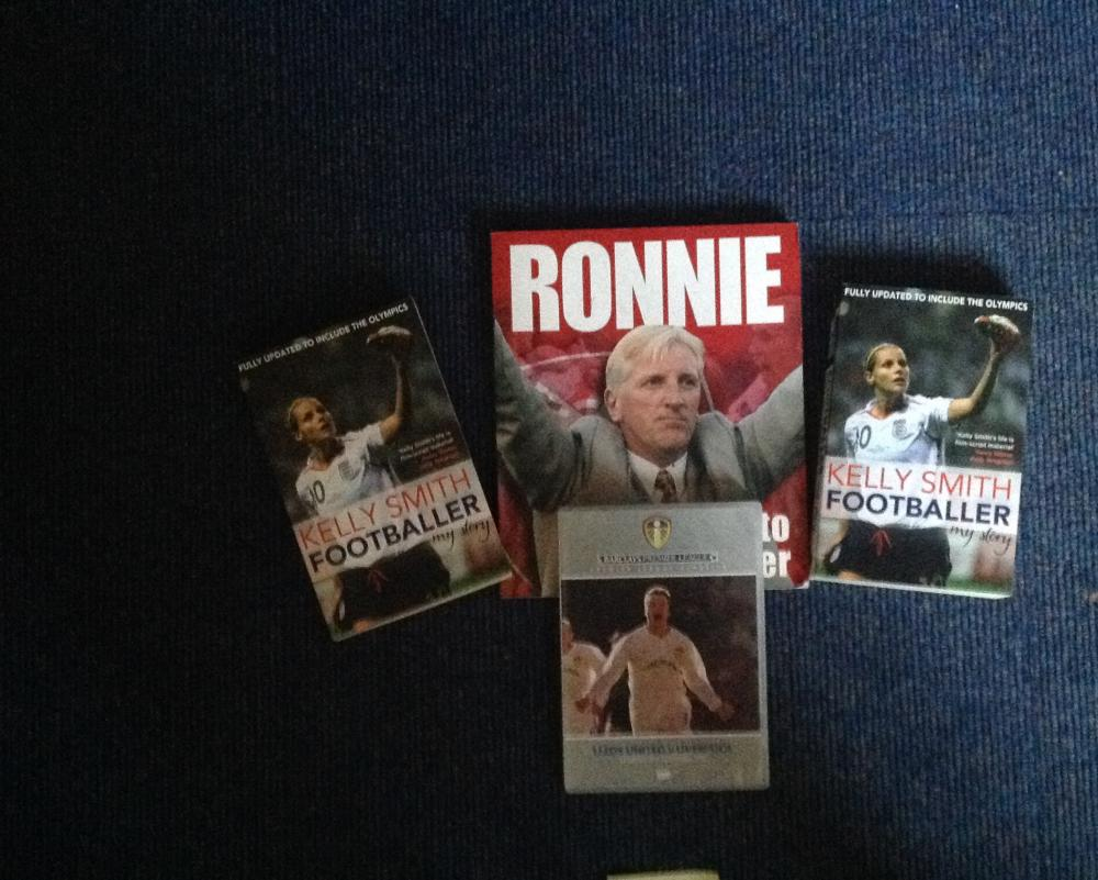 Football signed collection. Includes 3 signed books and one signed DVD sleeve. DVD sleeve signed