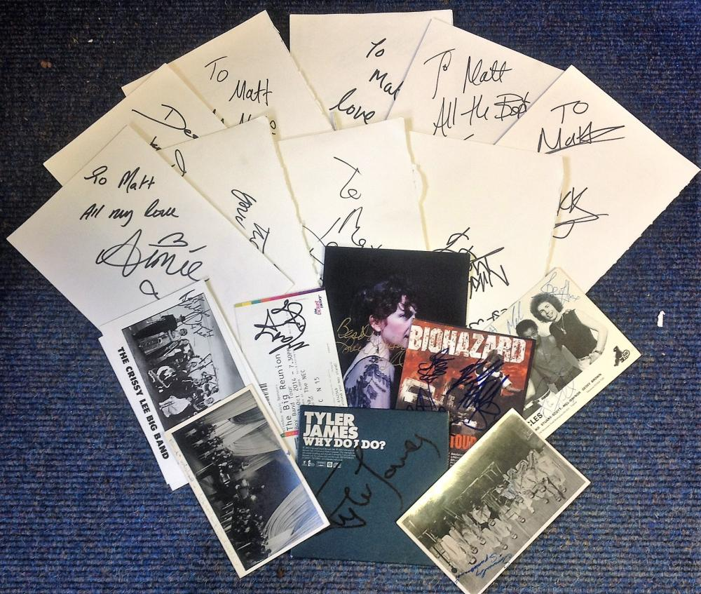 Music signed collection. 22 items. Assortment of signed album pages, flyers and photos. Some of