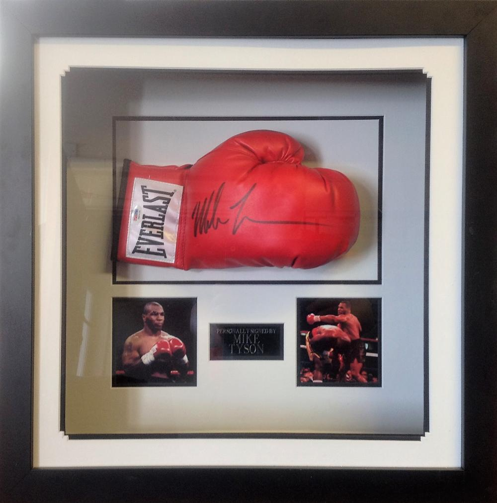 Mike Tyson signed boxing glove in a presentation case. Good Condition. All signed pieces come with a