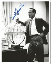 Scott Carpenter signed 10 x 8 b/w photo. Full length pose in business suit leaning against space
