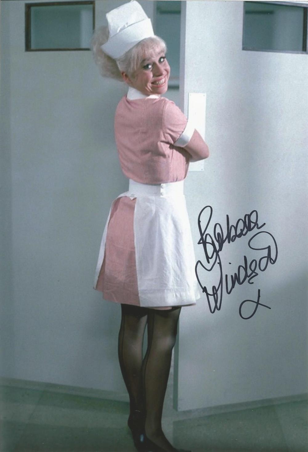 Carry on Nurse Barbara Windsor signed 12 x 8 inch colour photo in Nurse uniform. Good condition