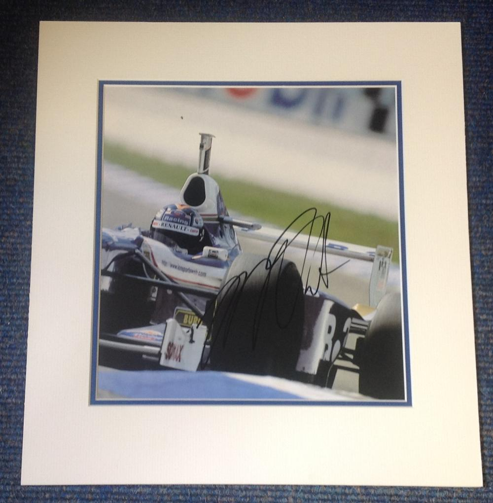 Heinz Harald Frentzen signed Williams photo. Mounted to approx size 15x14. Good Condition. All