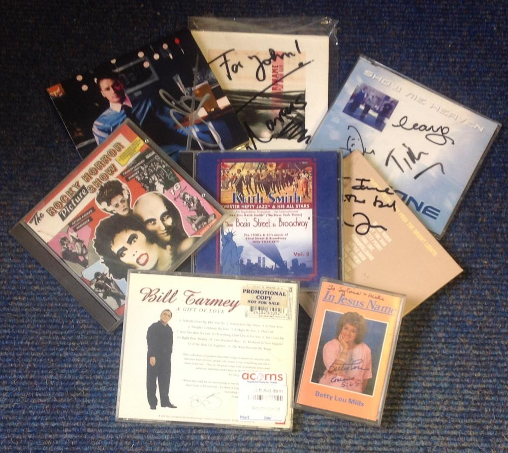 Signed music collection. Includes 7 signed cd sleeves. CD's included and one cassette tape. Some