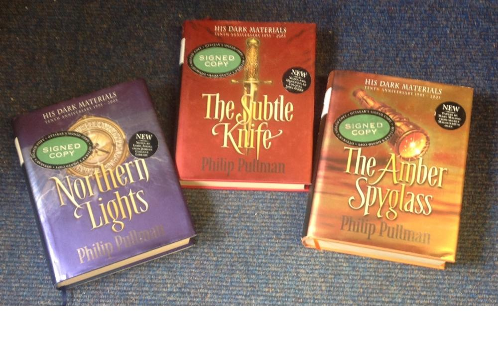 Philip Pullman signed His Dark Materials trilogy. 3 books. All have signed bookplate attached to