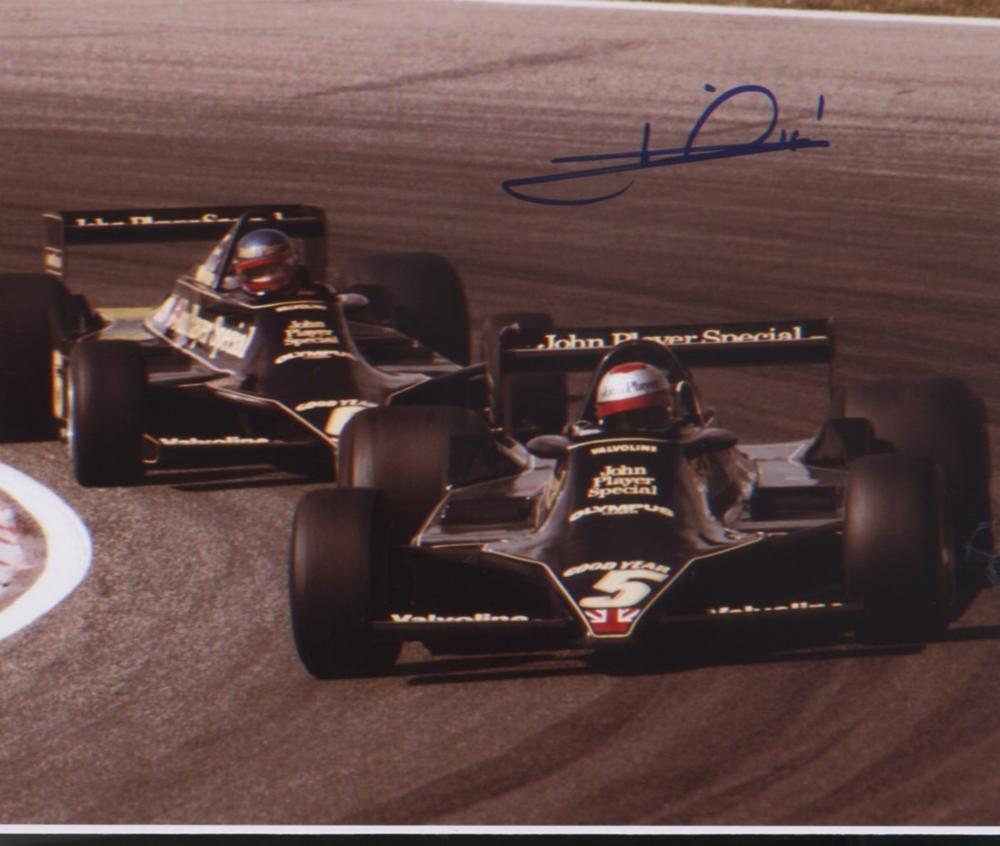 Mario Andretti signed 10x8 picture during Formula 1 race. Good condition. All autographs come with a