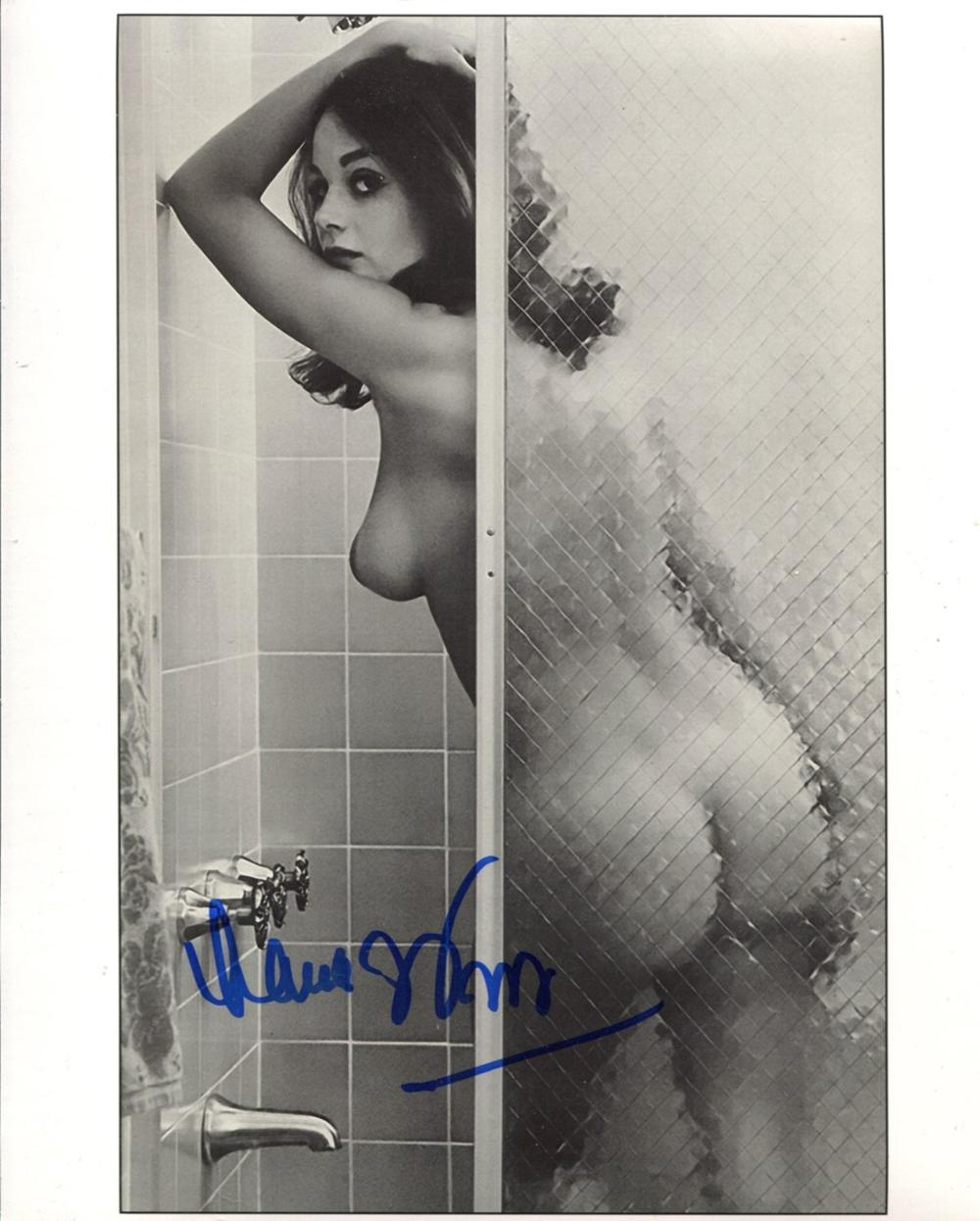007 Bond girl Lana Wood signed photo, desirable image of her naked in the shower. Good condition.