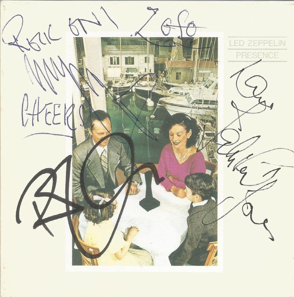 Robert Plant, Jimmy Page and John Paul Jones signed Led Zeppelin Presence CD sleeve. Good condition.