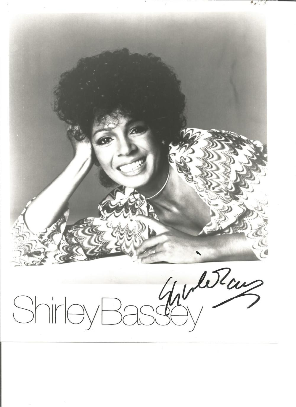 Shirley Bassey signed 10x8 b/w photo. Sang the theme tunes for 3 James Bond films. Good Condition.