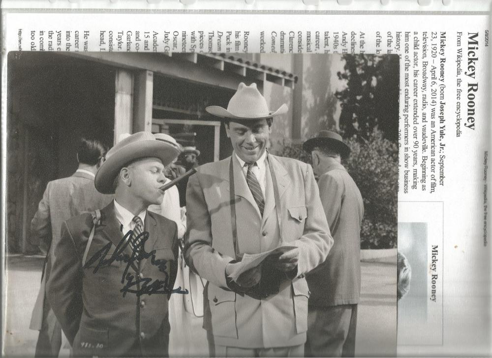Mickey Rooney signed 10 x 8 b/w young photo with biography page. Good Condition. All signed pieces