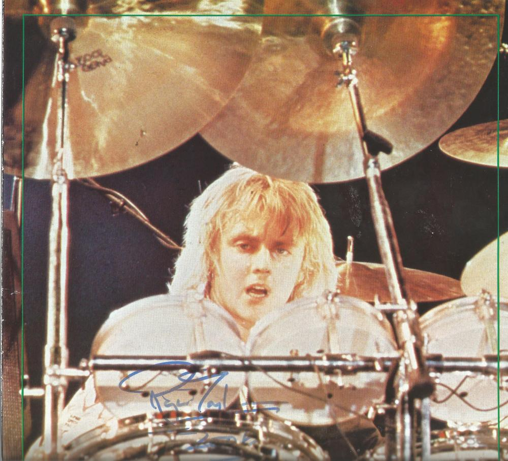 Roger Taylor Queen signed 8 x 8 colour music magazine photo. Good Condition. All signed pieces