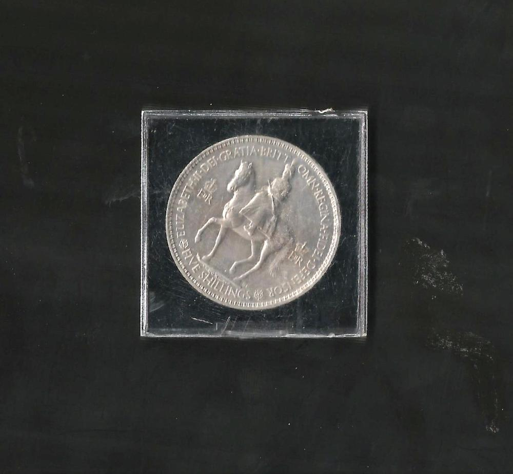 Five shilling coin in plastic case. Commemorating the Coronation of Queen Elizabeth II. Good
