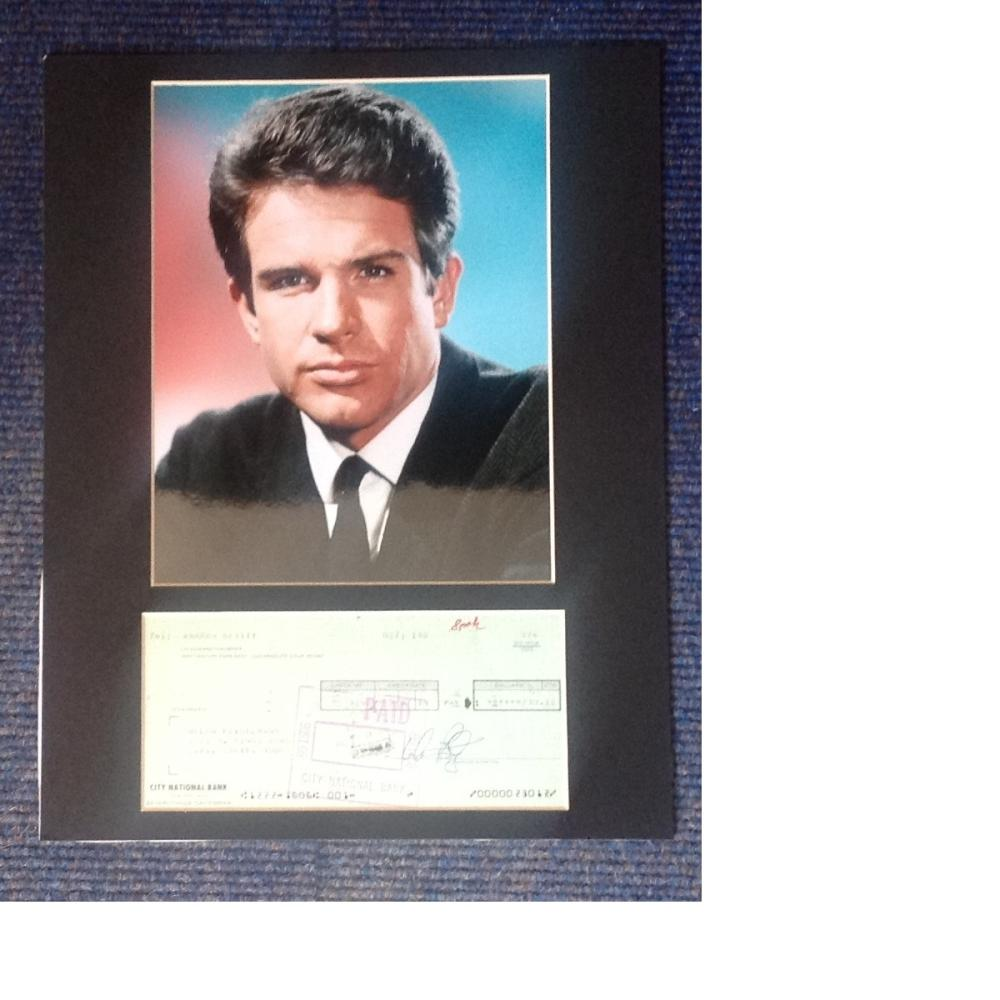 Warren Beatty signed cheque, mounted below colour photo. Approx overall size 16x12. Good