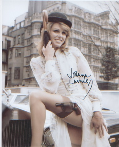Joanna Lumley. Sexy pose outside House of Commons.