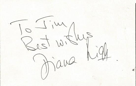 Diana Rigg signed white card.  Dedicated to Jim. A