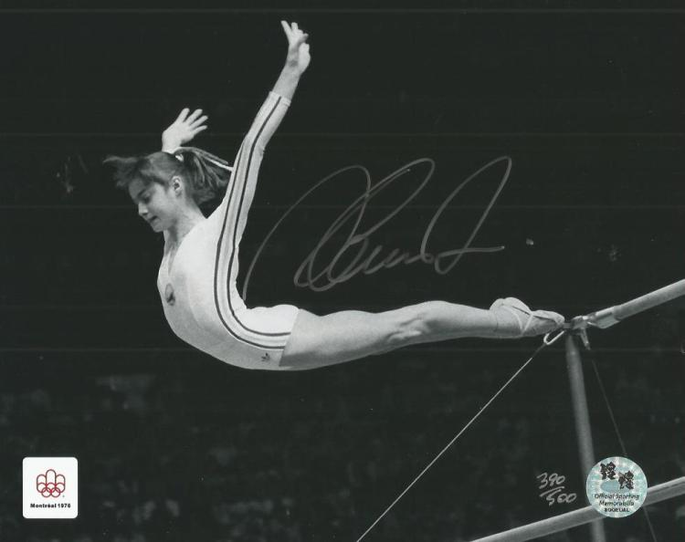 Nadia Comaneci autographed photo. Stunning black a