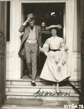 Gregory Peck signed 8 x 6 inch black and white still nice image of him in top hat and tails coming down the steps from a grand house