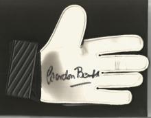 Signed Goalkeeping Glove Gordon Banks, A Black & Green Umbro Glove Superbly Signed Using A Black