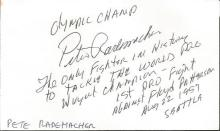 Peter Rademacher signed white card. 1956 heavyweight boxing Olympic gold medal winner. He fought