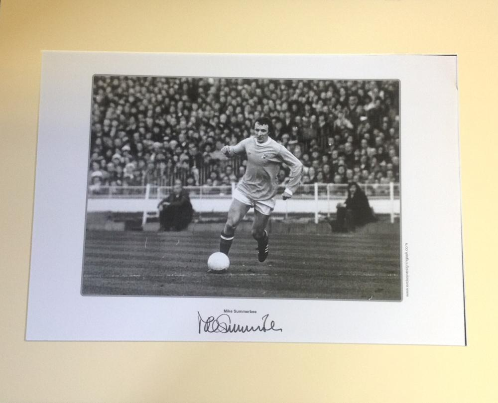 Football Mike Summerbee signed 16x20 mounted b/w photo pictured in action for Manchester City.
