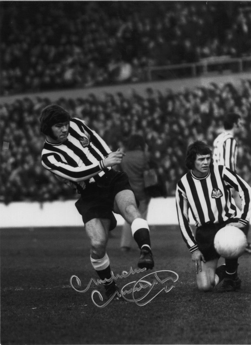 Football Malcom Macdonald 16x12 signed b/w photo pictured in action for Newcastle United. Good