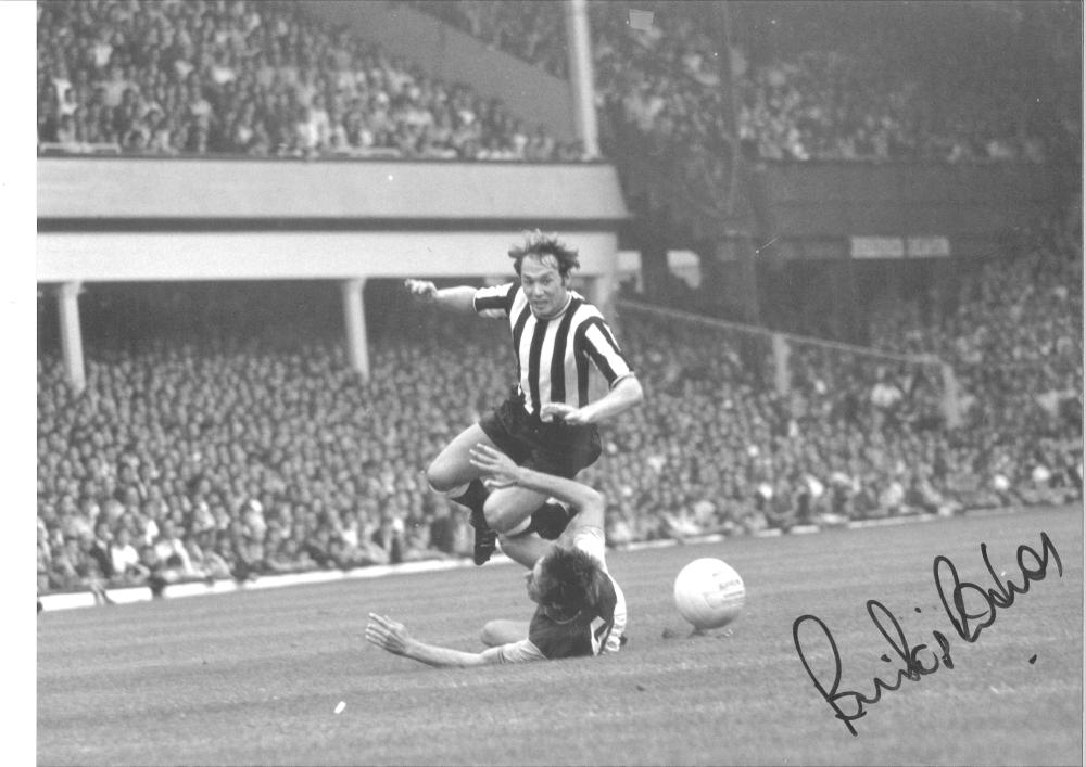 Football Bryan Pop Robson signed 12x16 b/w photo pictured in action for Newcastle United. Good