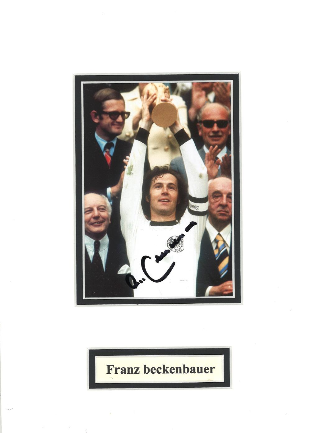 Football Franz Beckenbauer signed 11x8 mounted colour photo picture lifting the World Cup for
