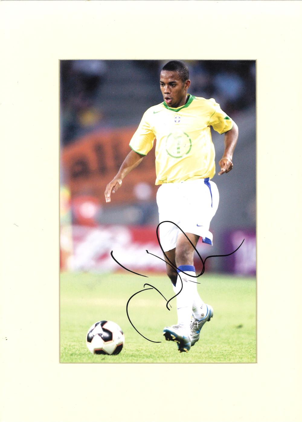 Football Robinho signed 16x12 mounted colour photo pictured in action for Brazil. Good condition