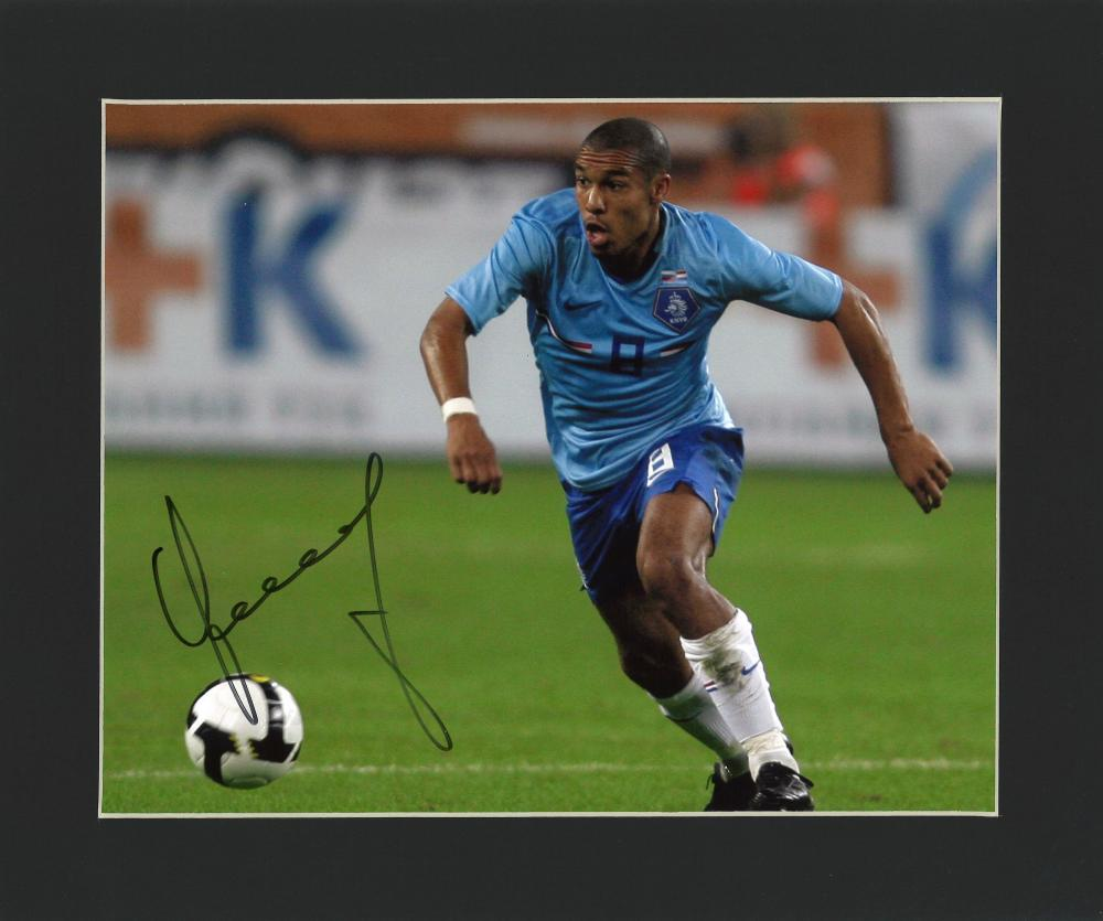 Football Nigel de Jong signed 10x12 mounted colour photo pictured in action for Holland. Good