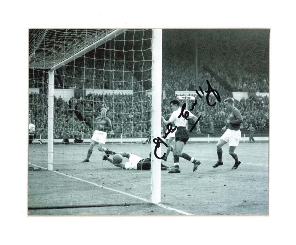 Football John Connelly signed 10x12 mounted b/w photo pictured in action for England. Good condition