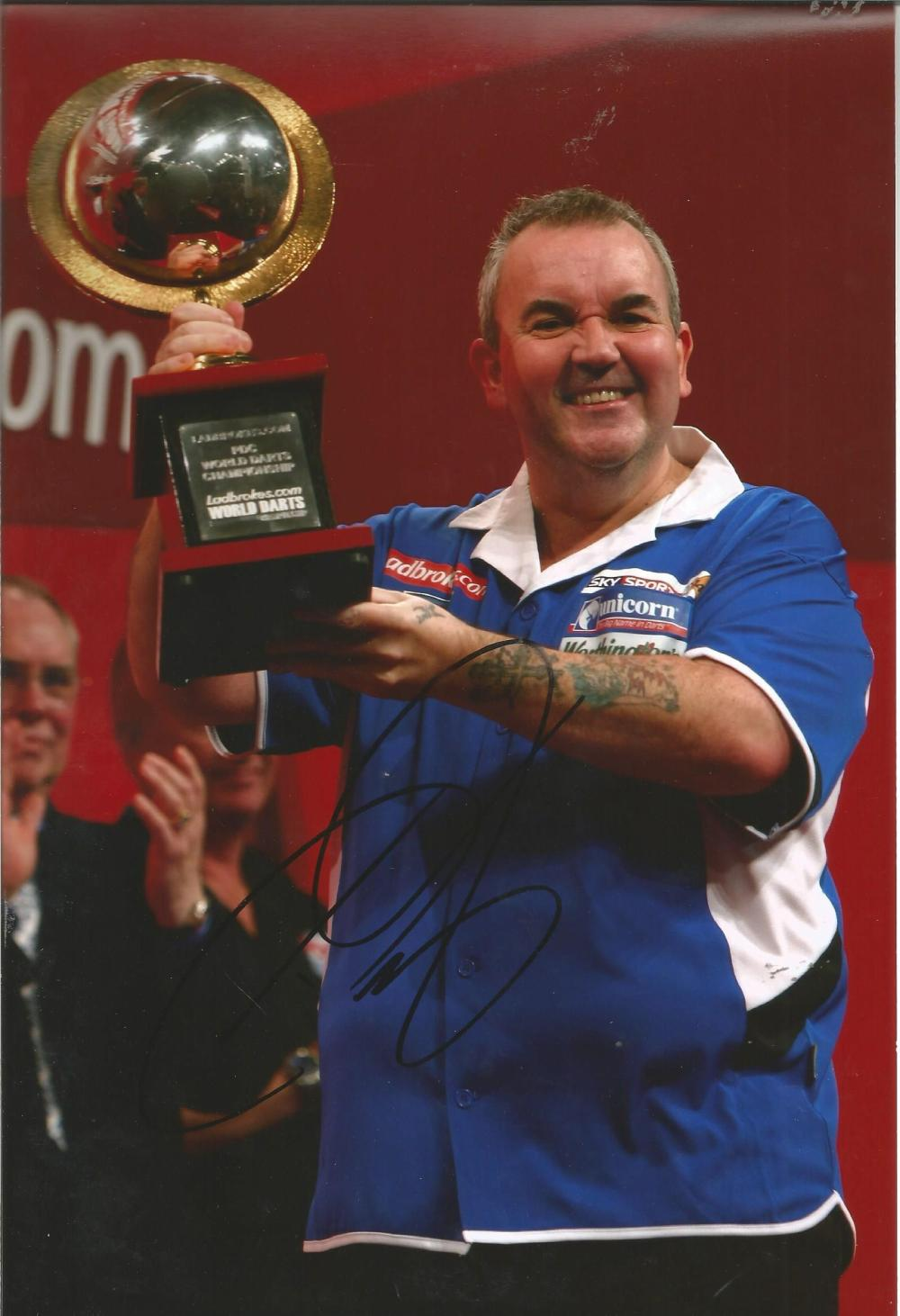 Darts Phil The Power Taylor 12x8 signed colour photo pictured holding the World Championship Trophy.