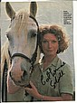 Catherine Schell signed 8 x 6 colour magazine photo from Film Wish me Luck mounted to 12 x 8 black card
