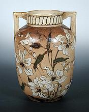 A Martin Brothers twin handled stoneware vase by Robert Wallace Martin,