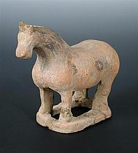 A Tang dynasty (untested) redware figure of a horse,